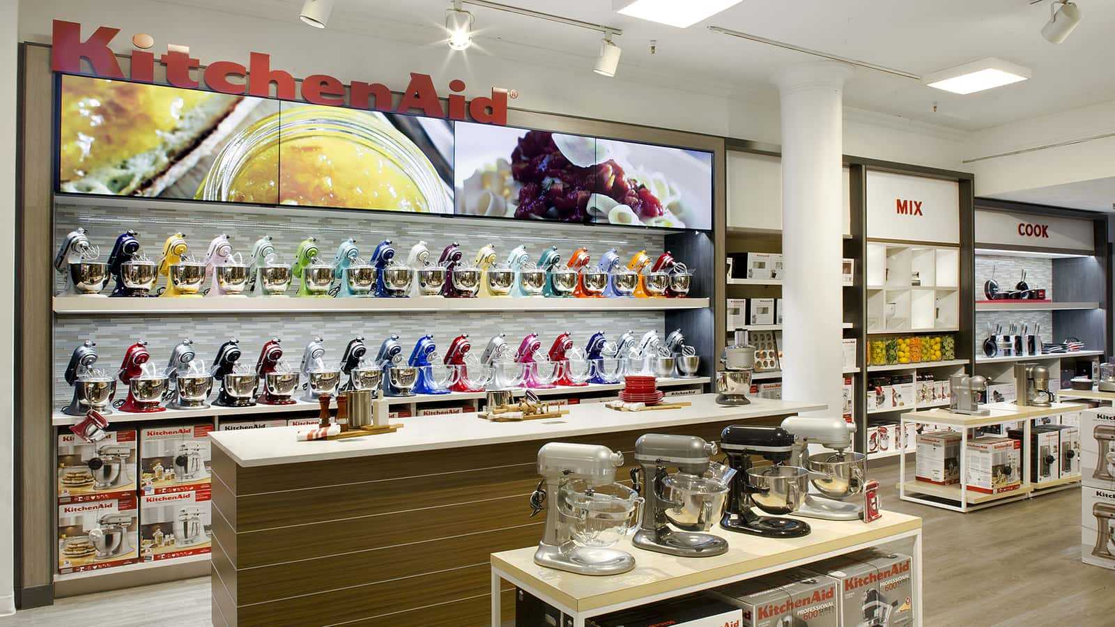 Left front view of KitchenAid mixers wall display at Macy's Herald Square.