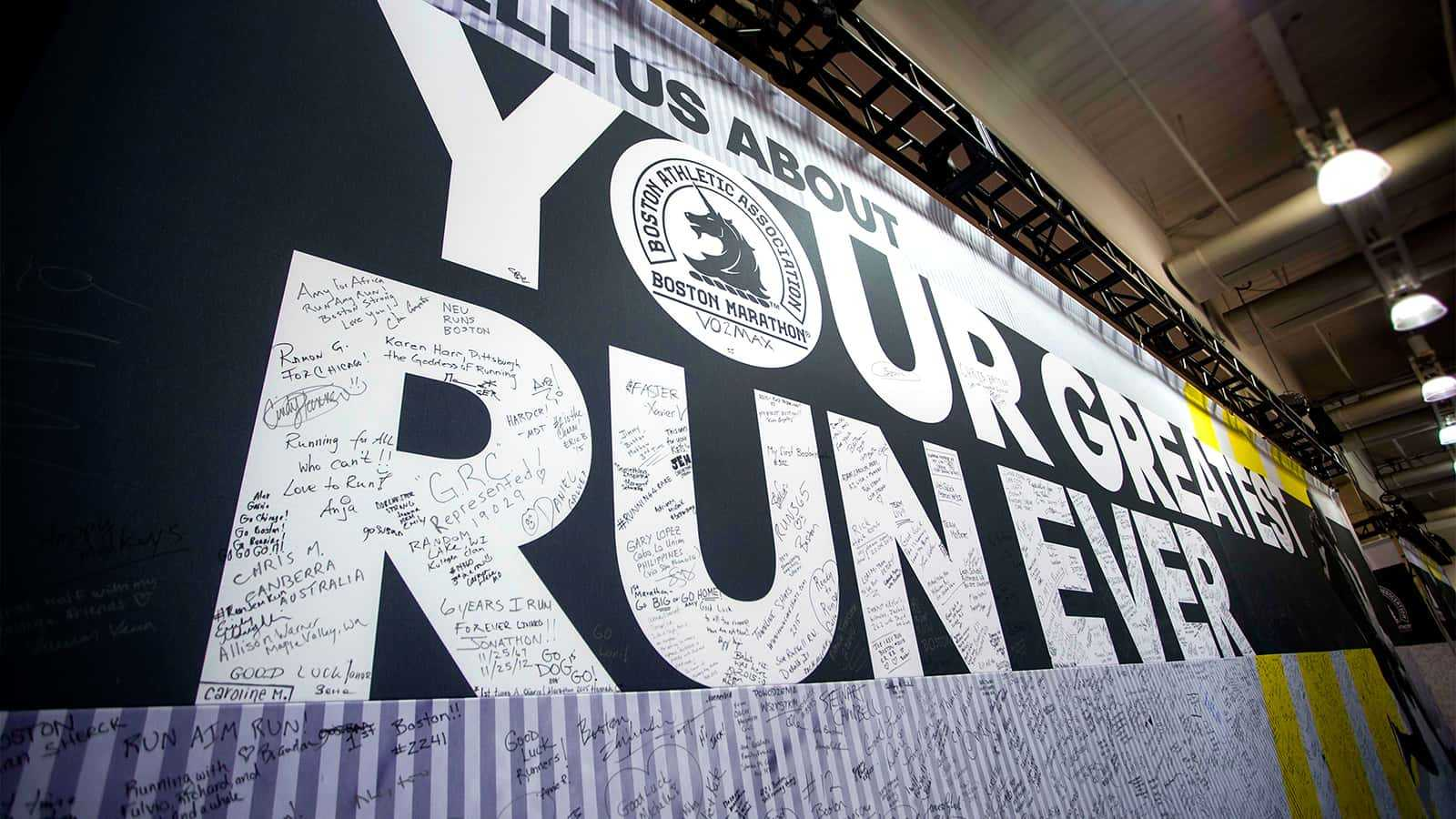 Close up view of Your Greatest Run Ever signage at adidas Boston Marathon store 2015.