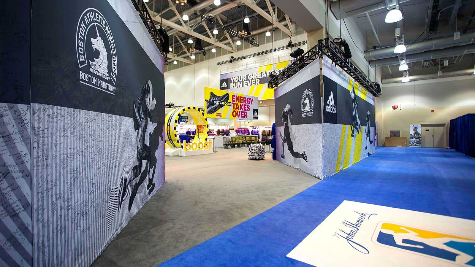 View of blue carpet entrance at adidas Boston Marathon store 2015.