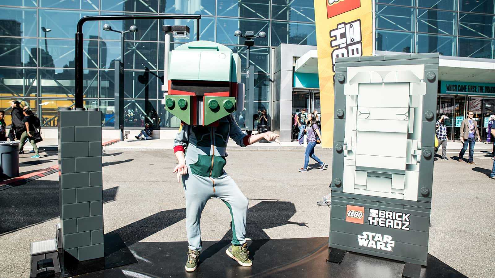 Fans of all ages snap photos with larger-than-life Boba Fett and Hans Solo in Carbonite to post #GoBrick social media messages from the LEGO Star Wars Brickheadz zone at New York Comic Con 2017.